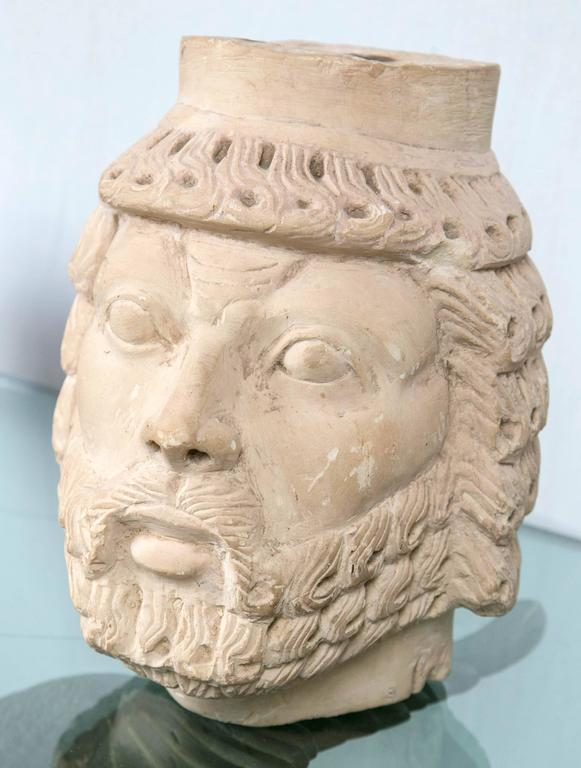 Unusual, but not antique, carved marble head of a bearded man.