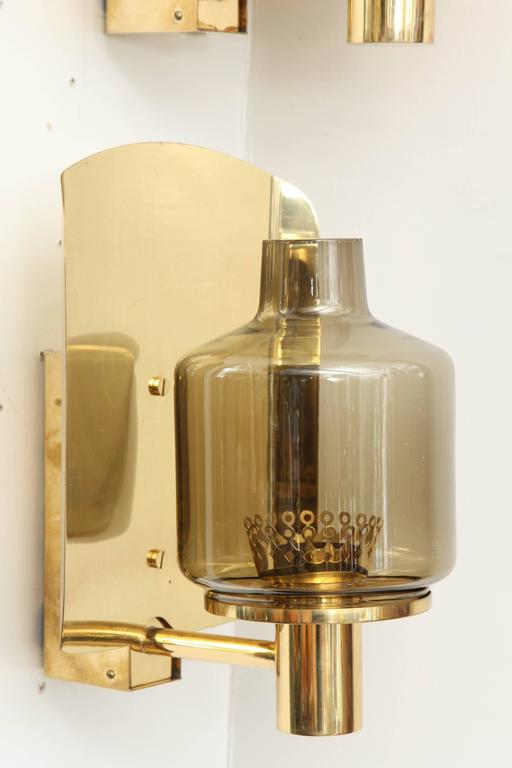 Swedish Pair of Brass and Smoked Glass Sconces by Hans-Agne Jakobsson For Sale