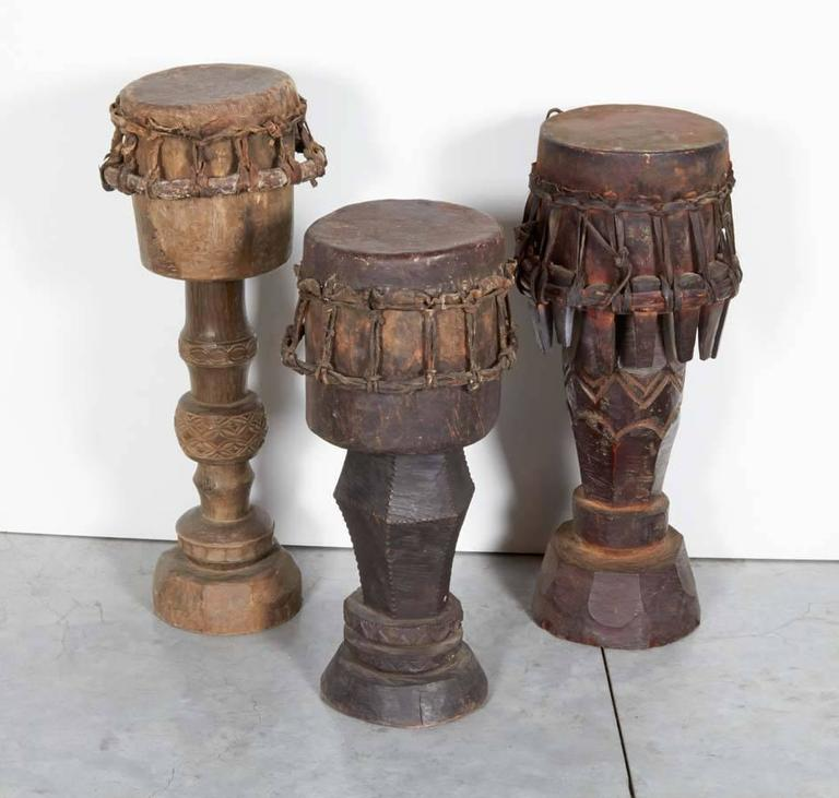 Three beautifully carved and patinated ceremonial drums from Sumba, Indonesia, circa 1930. Priced individually. Sizes vary. Left drum in main image is sold. M2017.
