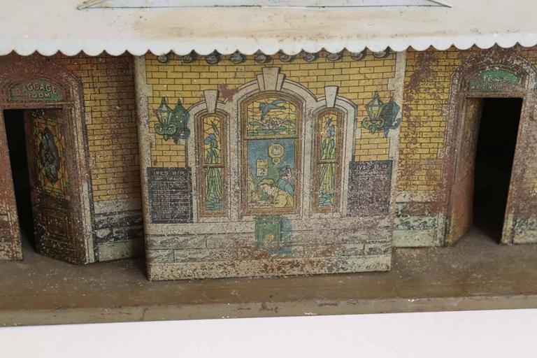 Vintage miniature train depot, original hand painted finish on tole. Fabricated for a 1930s toy train set.