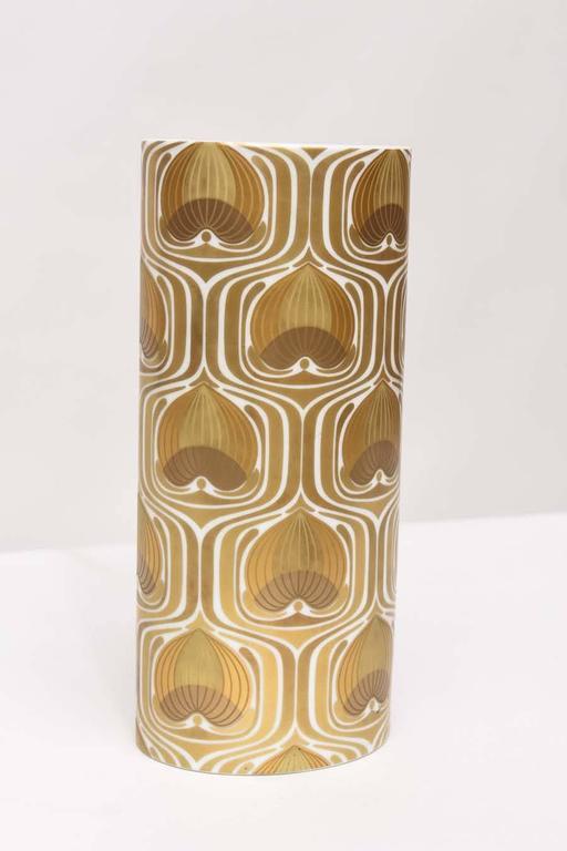 Oval cylinder vase designed byBjorn Wiinblad for Rosenthal, circa 1970. White porcelain with 24-karat gold decoration. Marked.