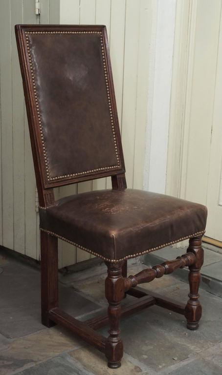 18th Century and Earlier Pair of 17th Century Leather and Walnut Side Chairs For Sale