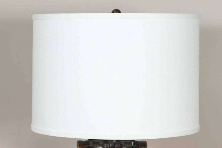 A table lamp from a flying shuttle barrel with custom shade.