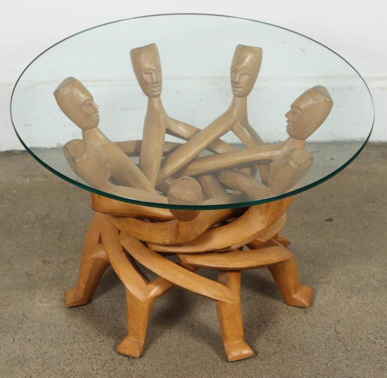 Handcrafted from one piece of wood, this African sculpture of seven men holding hands and staying together represent peace and equality. Created by Ghanaian artisan. These figures are linked together in solidarity, demonstrating that none of us can