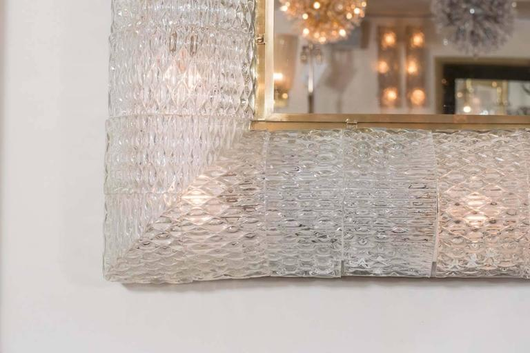 Monumental square mirror featuring illuminated textured Murano glass elements surround in the style of Barovier.