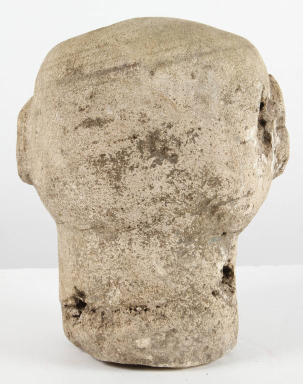 Carved stone head from timor at stdibs