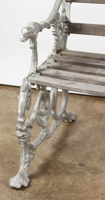 Unusual cast aluminum garden bench. Each side is done as a curving snake.