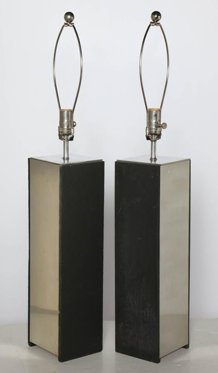 Tall Pair of International Style Laurel Lamp Company Black Slate and Aluminum Table Lamps.  In the manner of Paul Evans. Featuring two two sided vertical Black Slate and Aluminum Panels. Each panel measures 19H.  Reflective. Architectural.