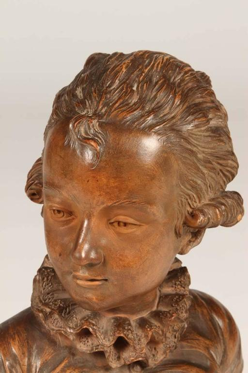 This absolutely lovely terra cotta bust representing Mozart as a child is from the 19th century. It is in excellent condition for a piece of it's age. It sits upon a turned walnut base. This is truly a treasure!