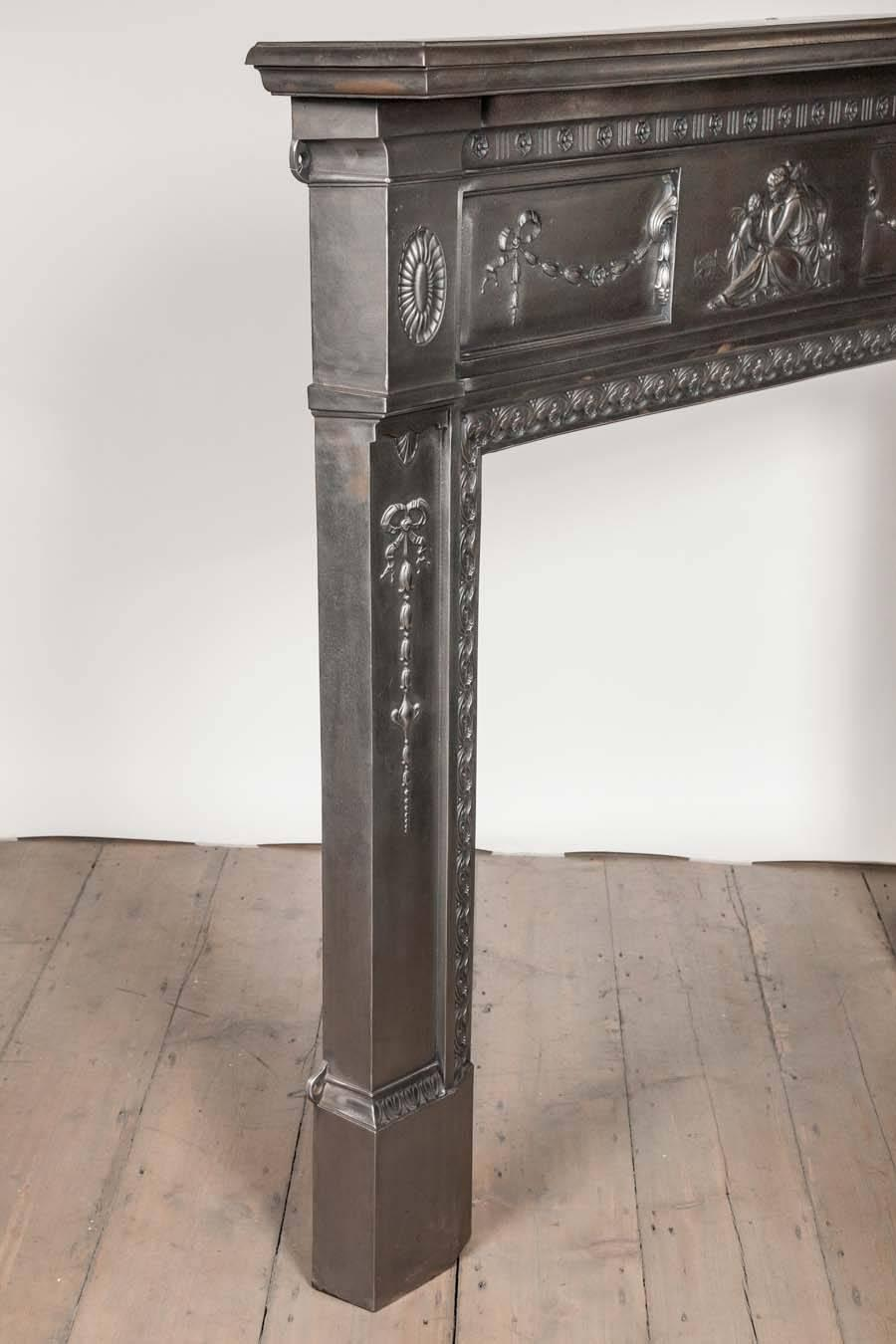 Antique Neoclassical Polished Cast Iron Fireplace Surround