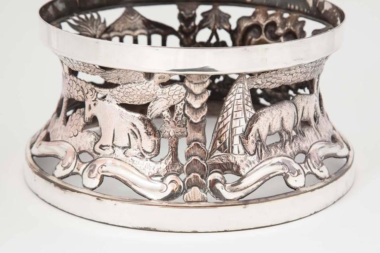 A fine late 18th century Irish silver plate dish ring or potato ring. It maybe used with a glass liner but originally made to contain a heater lamp and support a dish of food -