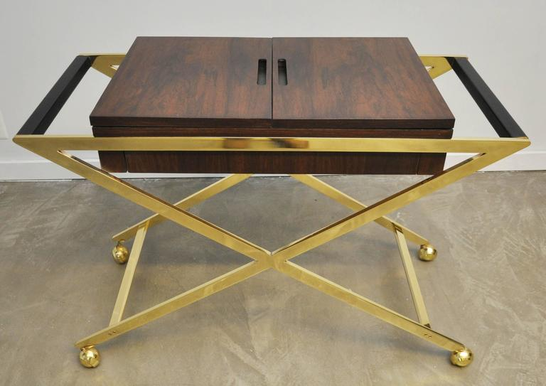Brass frame serving cart with dark mahogany case. Flip open top for additional serving space.