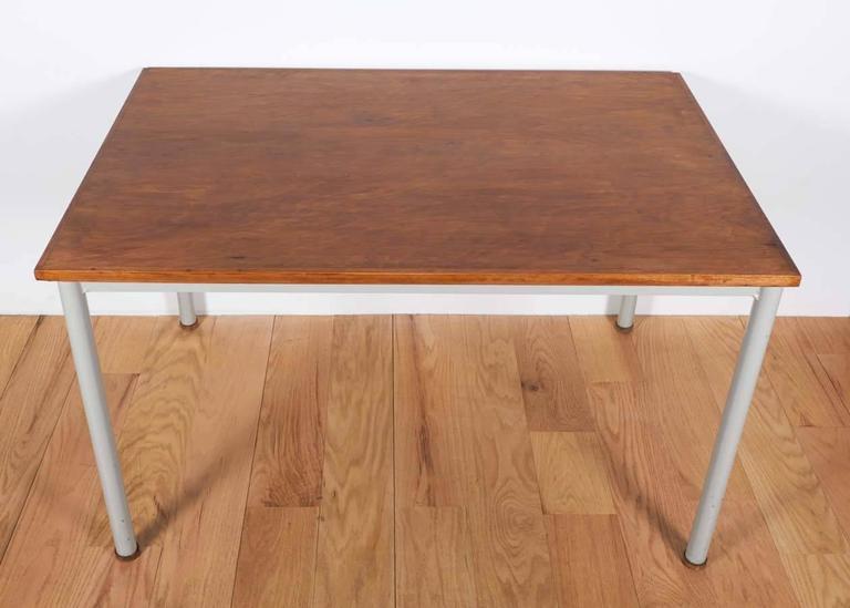 Le Corbusier table or desk, 1931-1932 Grey enameled metal and wood. All original.  Provenance: Pavillon Suisse, Cite Universitaire, Paris.
