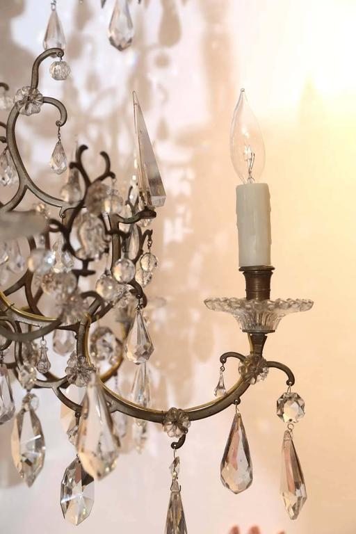 Venetian twelve-light chandelier, exquisite form with glass central. Post.
