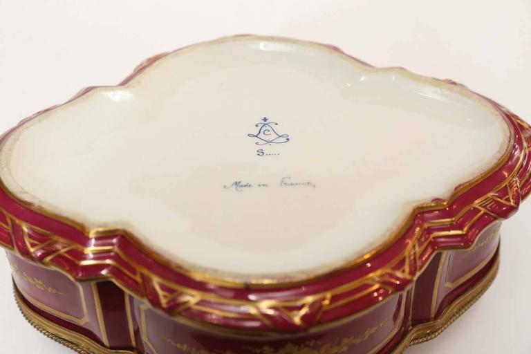 Painted Sevres Porcelain Box with Gilt Trim
