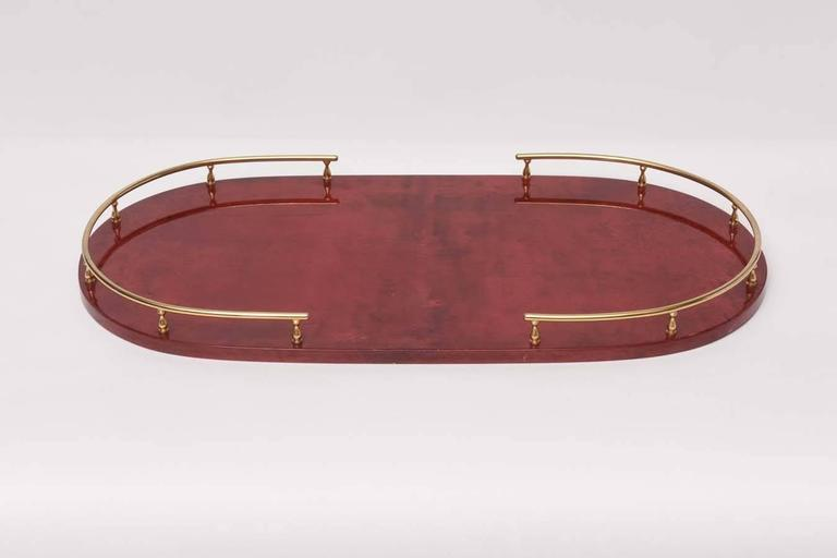 Red parchment serving tray by Aldo Tura, circa 1960.