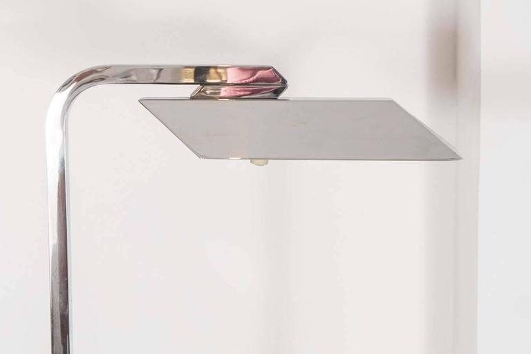 Adjustable Italian reading lamp with metal shade. Original finish.