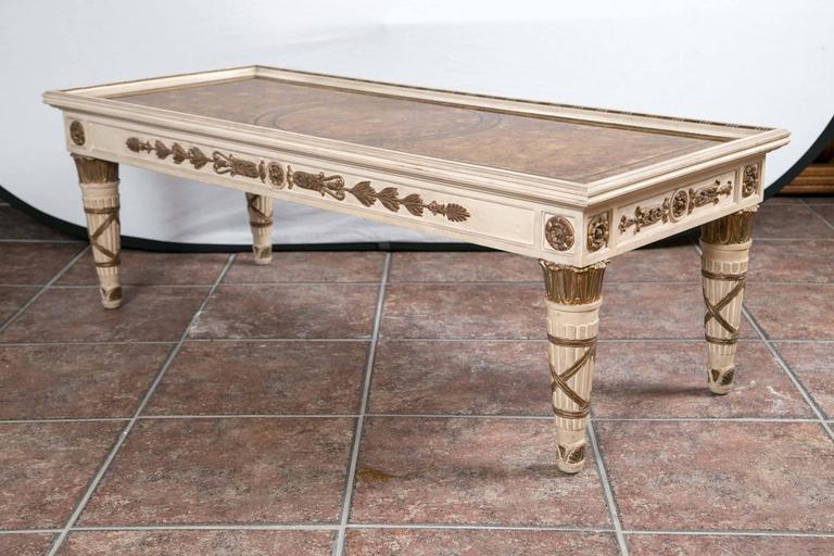 Maison Jansen Empire style coffee table having gilt decorated églomisé top over decorated apron.