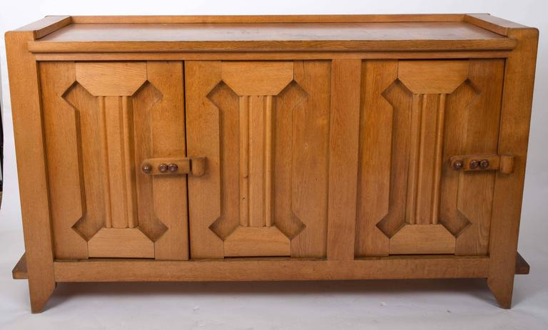 French oak credenza by Guillerme et Chambron with three doors and movable shelves inside.