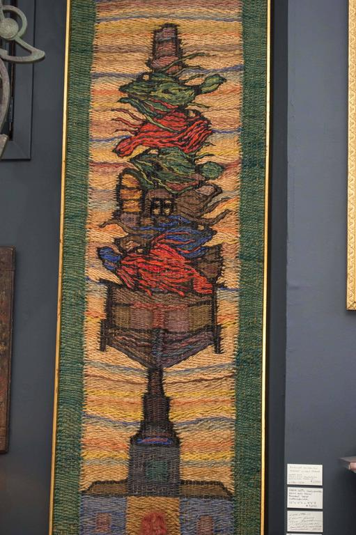 Framed hand-loomed jute weaving, circa 1970, by an unknown San Francisco artist. One of Four Seasons. Lively colors and intricate texture.