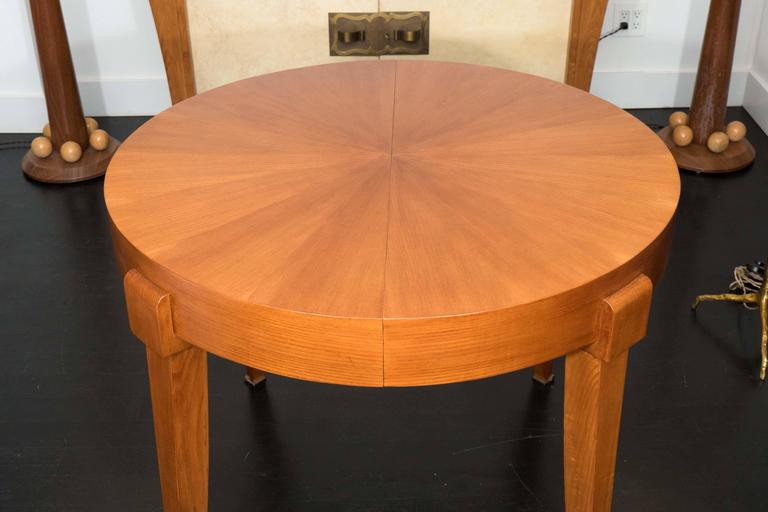 Oak center table with extendible marquetry top. Extensions not available, custom-made to order. Beautifully detailed legs with brass accents.
