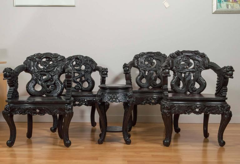 "A very expressive pair of ebonized and embellished antique Chinese chairs  that feature a fierce, - Pair Of Antique Hand Carved Chinese ""Dragon"" Chairs At 1stdibs"