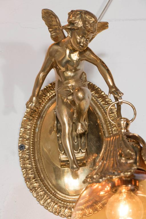 Brass Cherub Wall Sconces : Classic Pair of Brass Cherub Sconces with Cognac Globes For Sale at 1stdibs