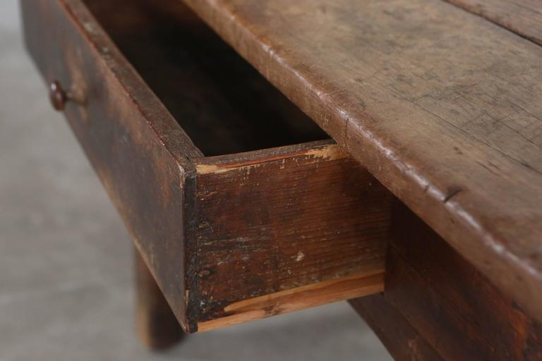 Rustic wood Primitive French single drawer rectangular table.