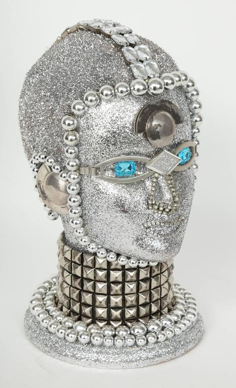 Futuristic silver metallic android bust by W. Beaupre composed of vintage jewelry findings.
