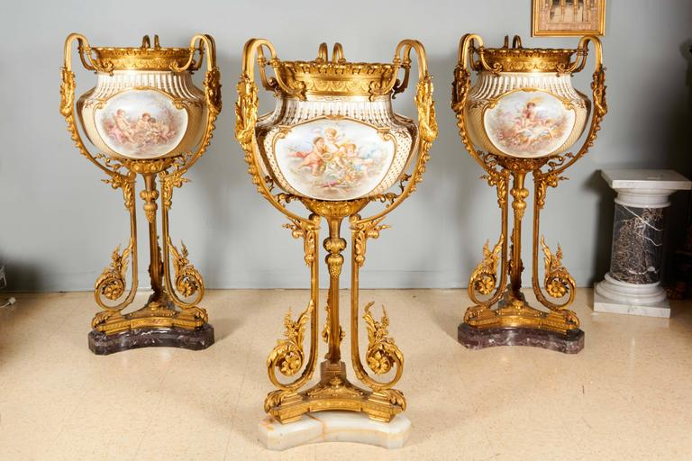 A highly important and monumental Sèvres-style porcelain jardiniere / vase, mounted in the finest ormolu. Most definitely commissioned for a royal family in Paris.  19th century, circa 1880.  Each body is molded with three large cartouches finely