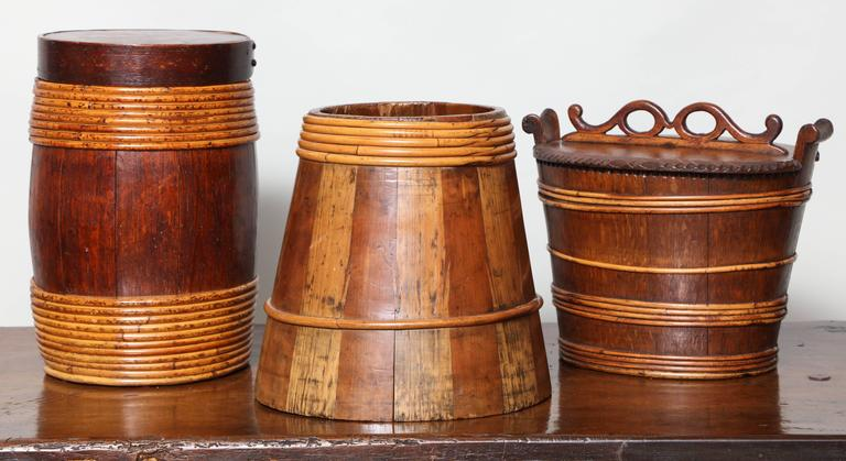 Collection of three 19th century willow banded treen vessels comprising:  A Scottish firkin in mixed woods, alternating pine (light) and fruitwood (dark) having feather joints holding the staves together and bound with willow, Ex. Collection A.J.