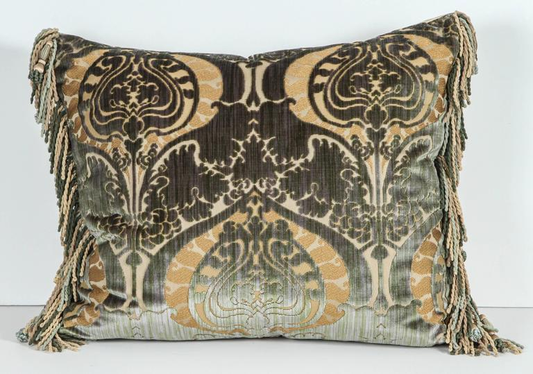 Pair of Luigi Bevilacqua silk velvet pillows with silk trim and silk velvet backing in golds and greens. Featuring Janet Yonati silk velvet backing and trim. Luigi Bevilacquat is the official fabric maker to the Vatican. The price listed for one