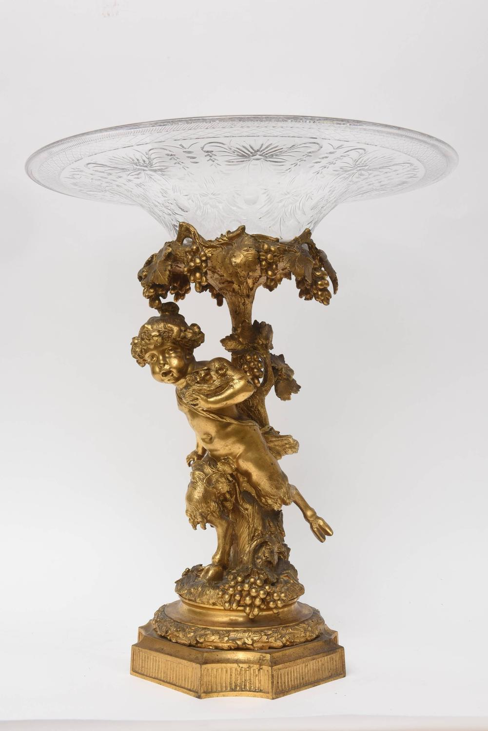 Antique gold doré bronze with bacchanal design and crystal
