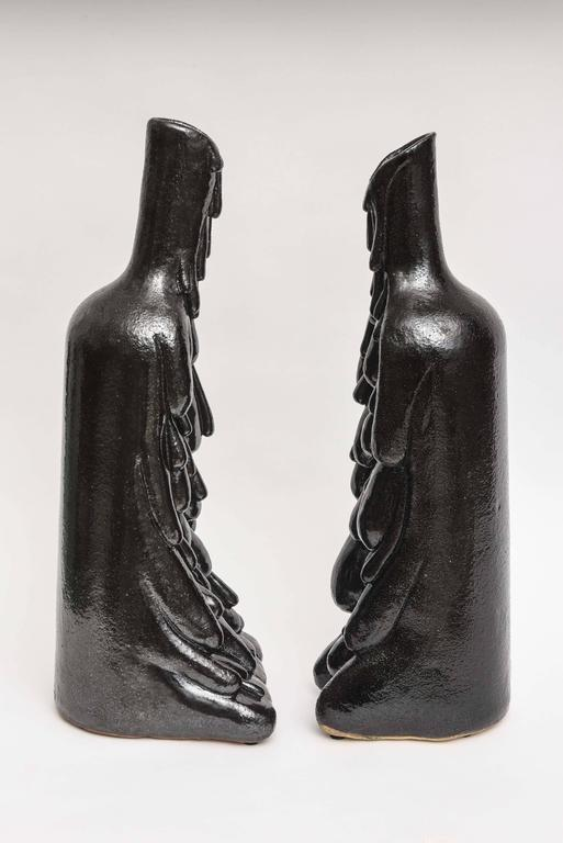 Large black glaze pair of ceramic vases/ sculptures by California artist/ceramicist Daric Harvie, can be sold separately.