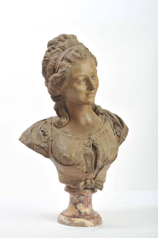 A good quality French 19th patinated terracotta bust of a classical lady, mounted on a Rouge marble sockel.