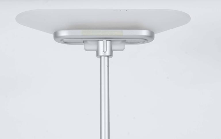 This very elegantly shaped Italian design lamp was the result of cooperation in 1978 of a trio of designers.  The shade and foot are both made of white frosted glass; the tube is made of stainless steel.  A good functioning dimmer with separate on