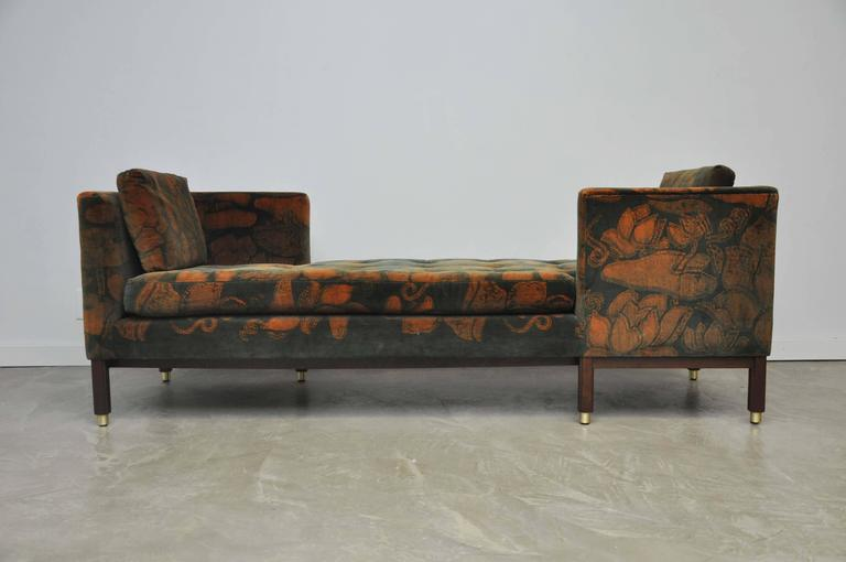 Pair of Dunbar Tete-a-tete sofas by Edward Wormley. Model 5944. Original Jack Lenor Larsen printed velvet over refinished espresso tone bases with brass details.