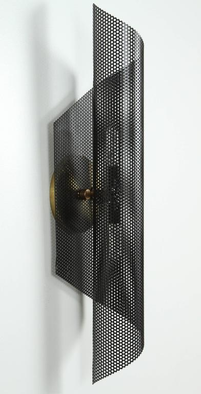 Rolled perforated sconce by Lawson-Fenning. In stock. Available to order in white or black with a 6-8 week lead time.