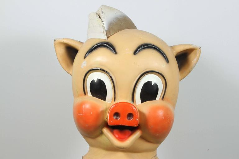 Iconic Piggly Wiggly trade sign parade costume head. Bigger than life and ready to wear a great piece of advertising art!