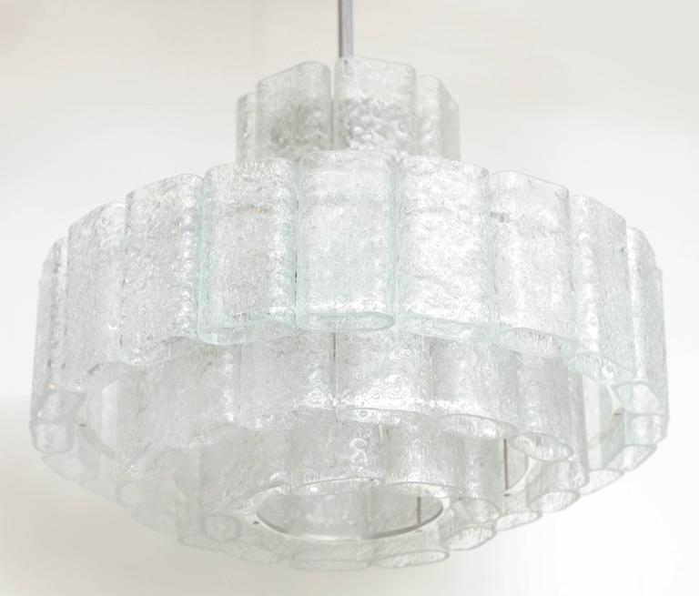 """Modernist chandelier composed of four tiers of oblong shaped ice glass elements. Chandelier is suspended from a polished nickel stem and canopy. Rewired for use in the USA. Chandelier measures 31"""" with chain, 14"""" tall is chandelier body only, 21"""" in"""
