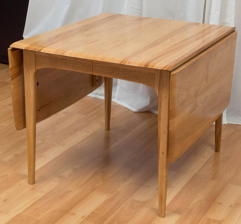 hickory wood drop leaf dining table in the manner of