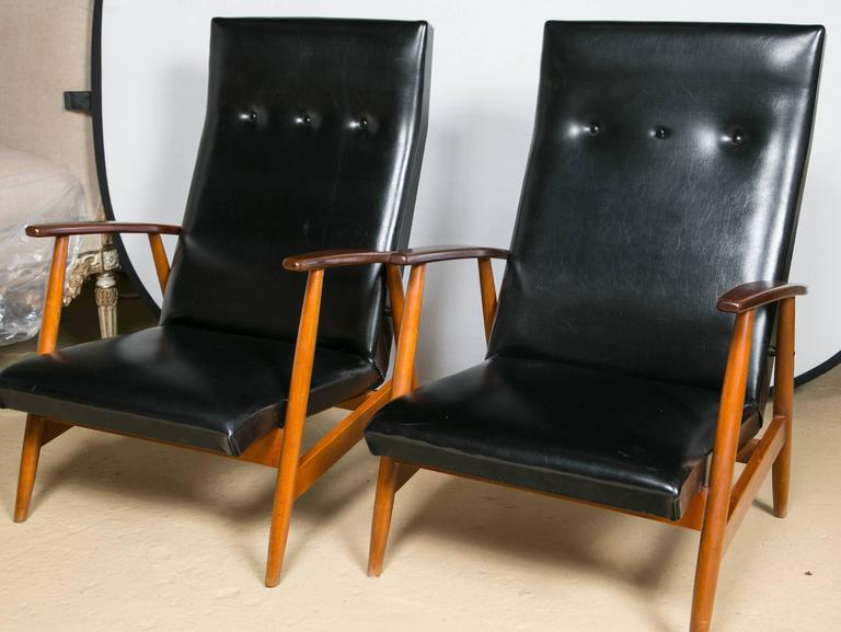 Pair of Scandinavian teak and black lounge chairs. Simplicity at its finest. This custom quality pair of lounge chairs has a wonderfully refined Mid-Century Modern look and design. The wood frames recently had rubbed French polished to a modest