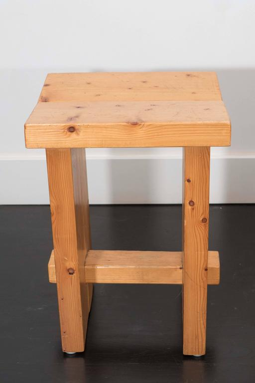 A pair of pine stools in the style of Perriand. Natural finish and dowel assembly.