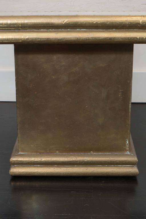 Elegant brass side table by Rodolfo Dubarry, etched and hammered panels.