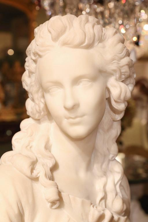White Carrara marble bust of a French woman, 19th century.
