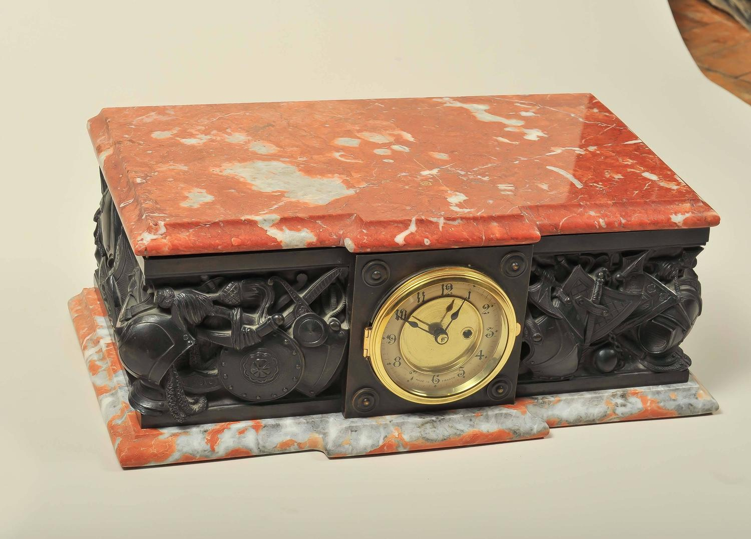 An Unusual Marble And Bronze Plinth Clock Depicting: unusual clocks for sale
