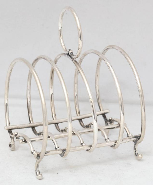 Unusual Victorian sterling silver footed toast rack, Gorham Manufacturing Corp. Providence, Rhode Island, year marked for 1898. Measures: 3