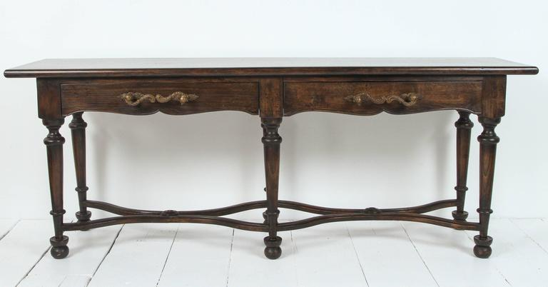 Vintage console with large wrought iron handles and six legs.
