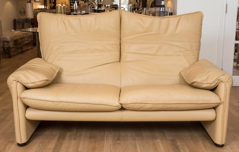 """This sumptuous 1973 designed Maralunga two-seat sofa has been recently reupholstered in a """"cafe au lait"""" colored executive leather. This Classic sofa is never out of style and built to last by world renowned furniture maker Cassina."""