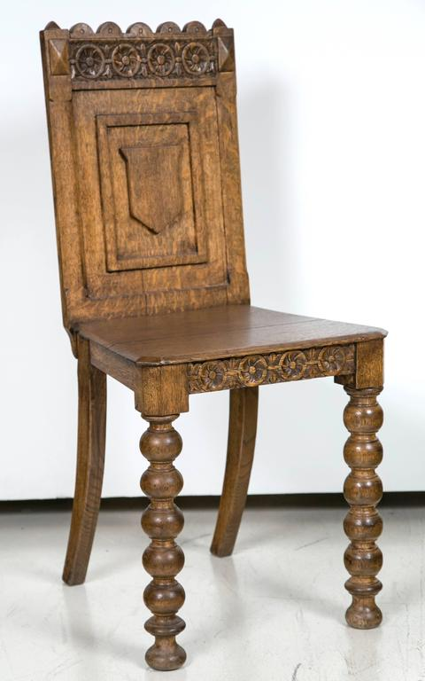 Antique, Germanic hall chair has decorative carvings on back and on the  apron. Carvings - Antique Germanic Hall Chair At 1stdibs